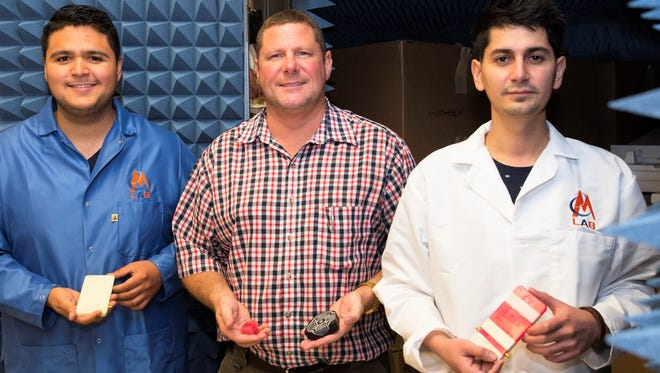 Raymond Rumpf, center, UTEP's EM Lab founder and director, is shown with student researchers Edgar Bustamante, left, and Cesar Valle.