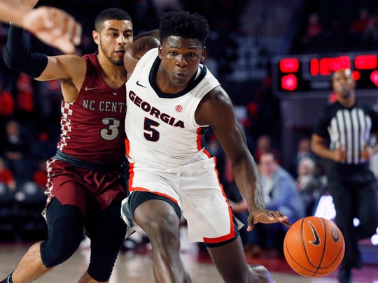 Georgia's Anthony Edwards (5) moves the ball past North Carolina Central guard Ty Graves (3) during an NCAA college basketball game Wednesday, Dec. 4, 2019, in Athens, Ga. (Joshua L. Jones/Athens Banner-Herald via AP)