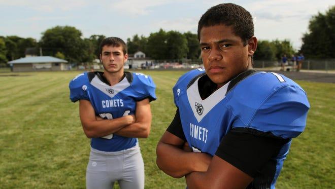 West Liberty senior quarterback Josh Walshire, right, and senior linebacker Chris McMichael.