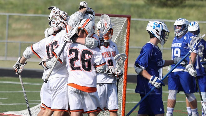 Birmingham Brother Rice  players celebrate a goal against Novi Detroit Catholic Central's during second half of the Division 1 lacrosse finals on Saturday at Parker Stadium in Howell.