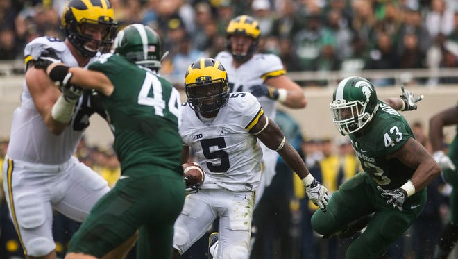 Michigan's Jabrill Peppers rushes the ball past Michigan State linebacker Ed Davis during U-M's 32-23 win Saturday in East Lansing.