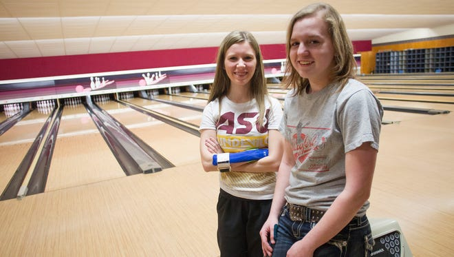City High's Taylor Hayslett, left, and Brooke Shaw pose for a photo during practice at Colonial Lanes on Monday,.