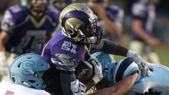 Clarkstown North's Dupree Darden carries the ball during