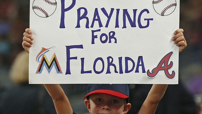 ATLANTA, GA - SEPTEMBER 07:  A young fan holds up a sign during the game between the Miami Marlins and the Atlanta Braves at SunTrust Park on September 7, 2017 in Atlanta, Georgia.  (Photo by Mike Zarrilli/Getty Images) ORG XMIT: 700012365 ORIG FILE ID: 843904160