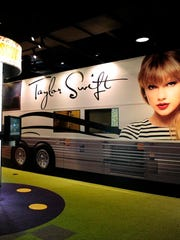 Inside  Country Music Hall of Fame and Museum's new new technology-enhanced exhibits includes a  40-foot guitar, recording booth and a replica of taylor Swift's tour bus.