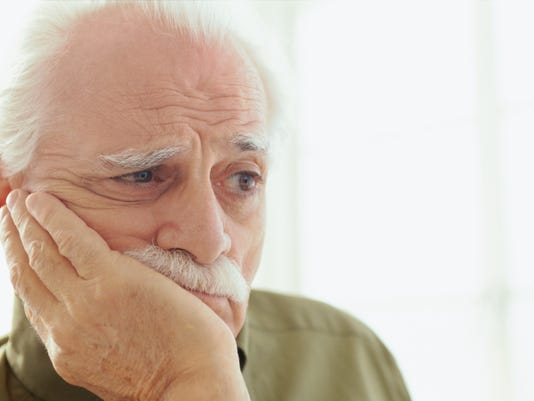 close-up of an elderly man lost in thought