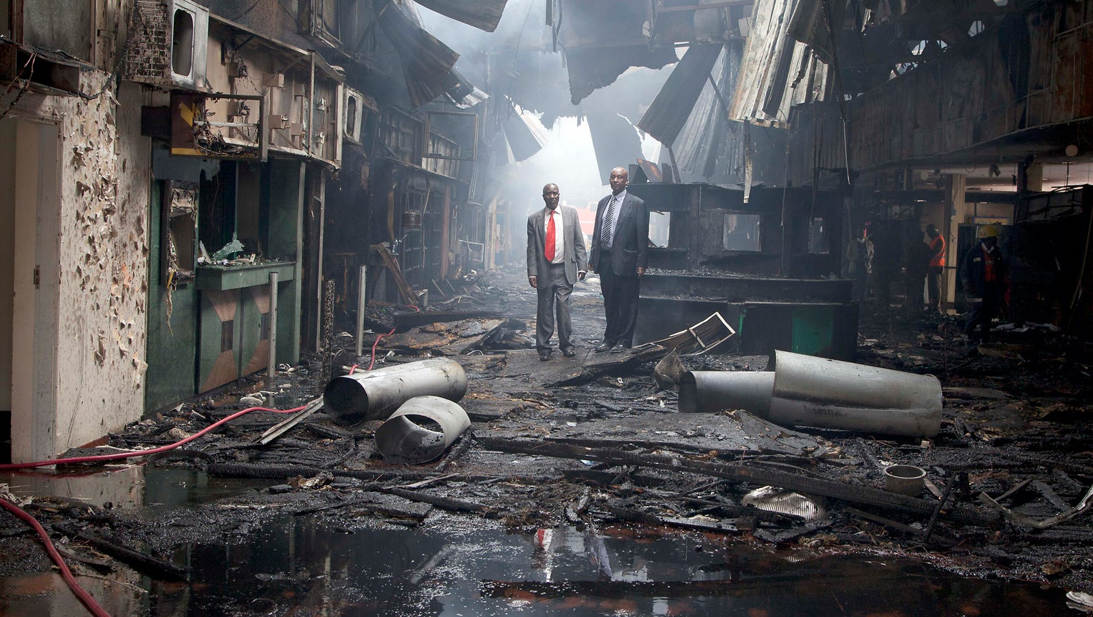 Kenyan airport officials inspect the destroyed main terminal building.