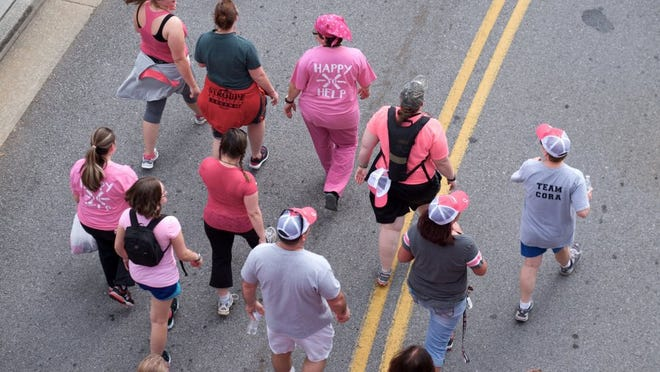 A group of supporters make their start during the American Cancer Society Making Strides Against Breast Cancer walk at the World's Fair Park on Sunday, October 2, 2016.