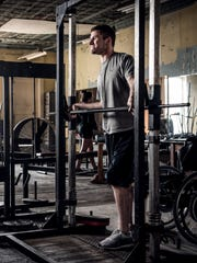 Chris Norton works out to gain strength to walk his