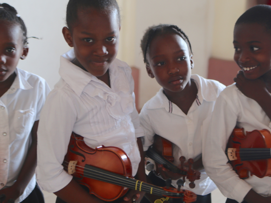 A young string quartet in Cange, Haiti.