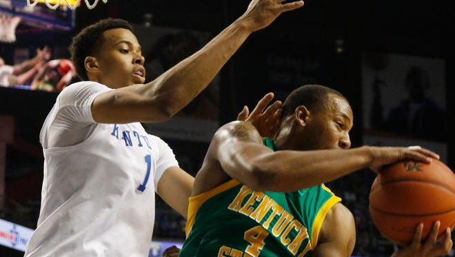 Kentucky State's Malcolm Smith, right, pulls down a rebound near Kentucky's Skal Labissiere during an NCAA college basketball exhibition game Friday, Nov. 6, 2015, in Lexington, Ky. (AP Photo/James Crisp)