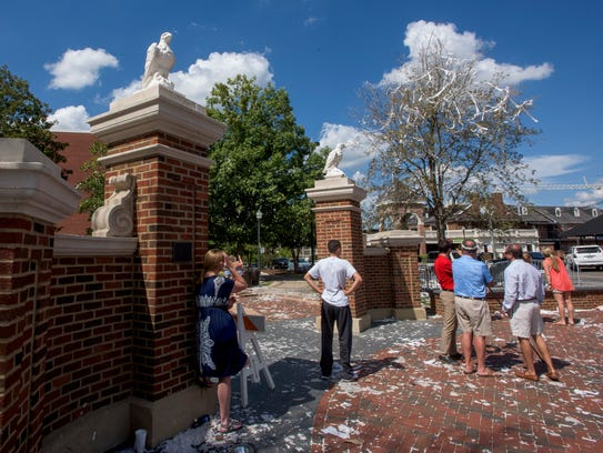 Fans gather at the oak tree at Toomer's Corner in Auburn,