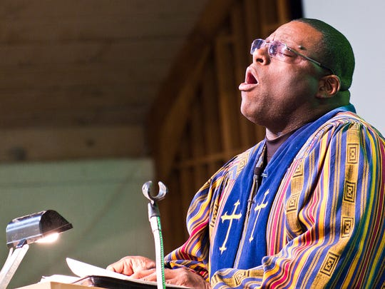 Reverend David Ford, Pastor of Friendship House of Prayer Baptist Church preaches to his congregation in their new church at 4301 S. Waverly Rd. in Lansing on Easter Sunday, March 27, 2016.