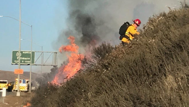 Firefighters battled a blaze burning along the southbound side of Highway  101 Thursday in Thousand Oaks.