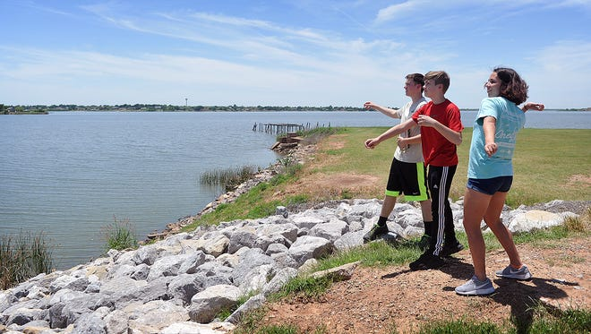 Matthew Castro, left, Brady Tressler and Tatyana Garcia spent some time at Lake Wichita after the last day of school Friday. This weekend marks the two-year anniversary of the area lakes and reservoirs reaching 100 percent capacity following a four-year drought.
