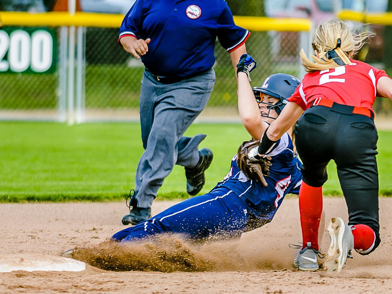 Maranda Barton ,bottom, of Lakewood beats a tag by Katie Eppard ,2, of Laingsburg to steal 2nd in the 6th inning of their Softball Classic first round game Tuesday May 17, 2016 at Ranney Park in Lansing. KEVIN W. FOWLER PHOTO