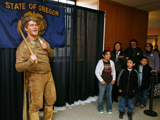 Evan Christopher was the living Gold Man during Oregon's 150th birthday celebration at the Capitol on Saturday Feb. 14, 2009.