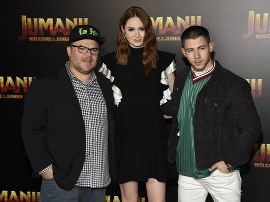 """Jack Black, from left, Karen Gillan and Nick Jonas, cast members in the upcoming movie """"Jumanji: Welcome to the Jungle."""""""