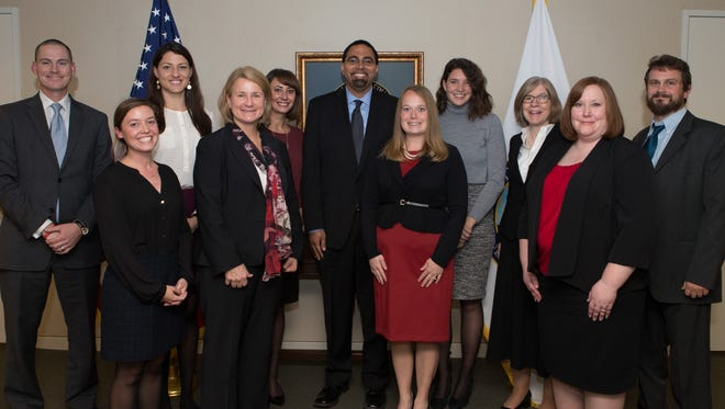 Teachers from the Oshkosh Area School District and other school districts around the country pose for a photo with U.S. Secretary of Education John King during a meeting to discuss personalized learning efforts in November.