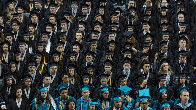The Oñate High School Class of 2017, waiting to begin their graduation ceremony. Monday, May 22, 2017 at the Pan American Center.