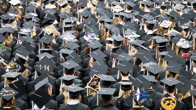 Graduate candidates listen to a speech during a University of Iowa commencement ceremony for the College of Liberal Arts and Sciences at Carver-Hawkeye Arena on May 12, 2018.