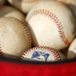 A bag full of baseballs.