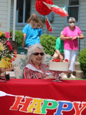 Esther White got an early start to celebrating her birthday Saturday with an event outside her home, which is across the street from Monmouth's campus. Birthday cake was served curbside, and passers-by were encouraged to honk and wave.