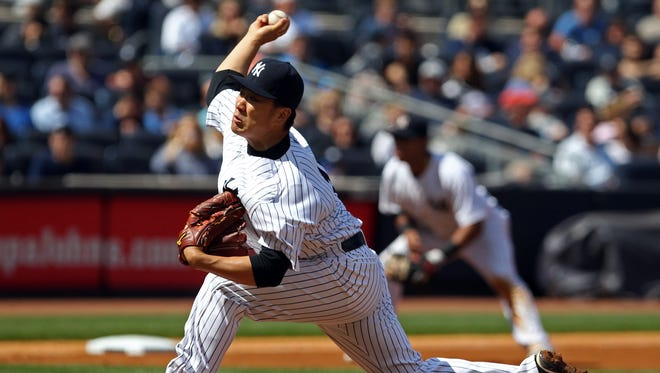 The Yankees' Masahiro Tanaka delivers a pitch in the sixth inning against the Minnesota Twins at Yankee Stadium.