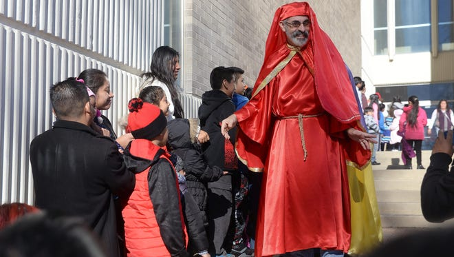 Miguel Cruz, of Vineland (center), dressed as one of the Three Kings, processes outside City Hall during the The Puerto Rican Festival of New Jersey's celebration, Sunday, Jan. 3, 2016 in Vineland.