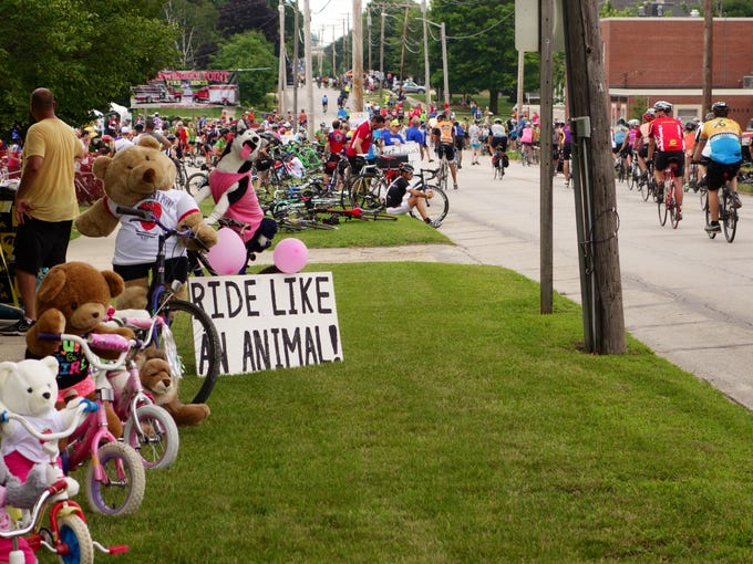 Riders roll through strawberry Point on the last day of RAGBRAI Saturday, July 26, 2014.