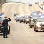 Law enforcement escort slain officer home
