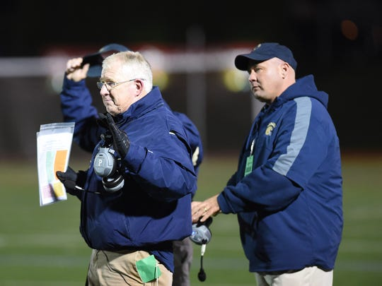 Our Lady of Lourdes High School football coach Brian Walsh, left, directs his team during Friday's Class A state semifinal win over Amsterdam at Dietz Stadium.