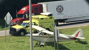 Small plane hauling Lady Antebellum banner lands on interstate in downtown Nashville