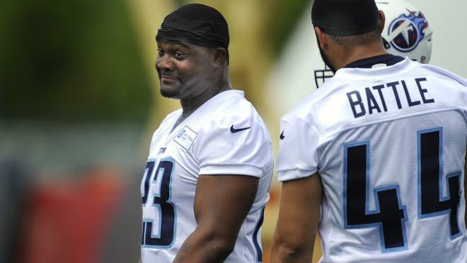 Titans running back Shonn Greene laughs during Tuesday's practice at Saint Thomas Sports Park.