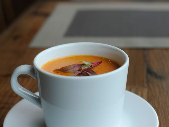 A crab and pepper bisque dish is shown at the Riverview