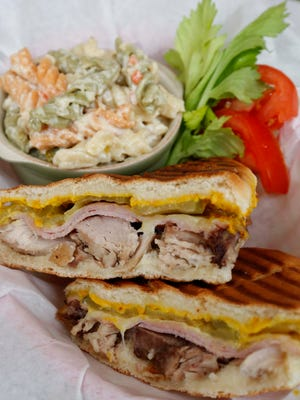The Cuban sandwich with spicy pasta salad at Artisan Oven on C-Street in Springfield.