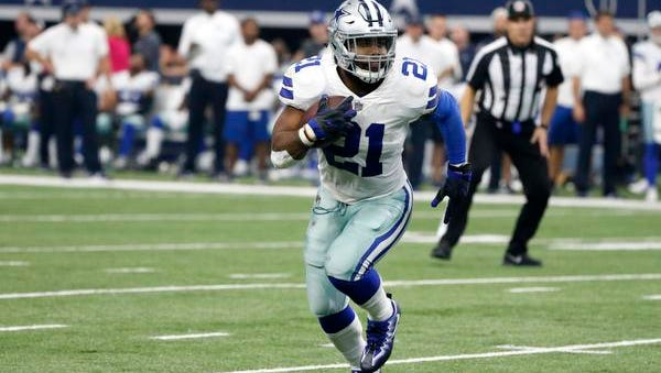 Dallas Cowboys' Ezekiel Elliott (21) carries the ball against the Green Bay Packers during an NFL football game, Sunday, Oct. 8, 2017, in Arlington, Texas.