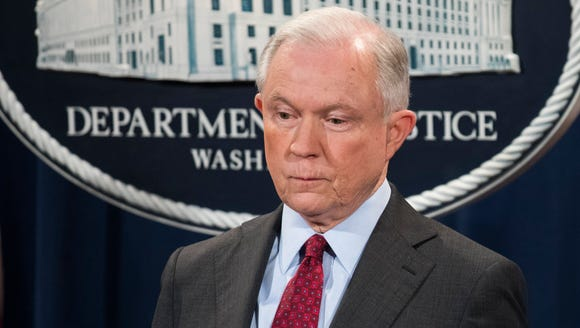 Attorney General Jeff Sessions waits to speak to the