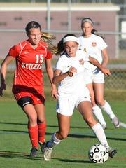 Arlington's Sofia Germano dribbles the ball ahead of