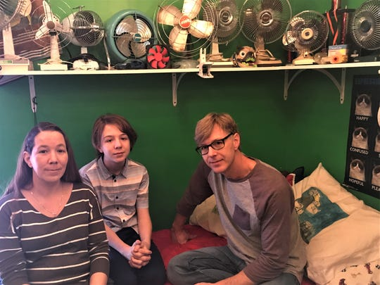 """""""Fan Boy"""" Reece Umbreit, 13, of North Fond du Lac, sits in his bedroom with his parents Cindy and Jason Umbreit. The 13-year-old middle school students has a collection of more than 400 fans."""