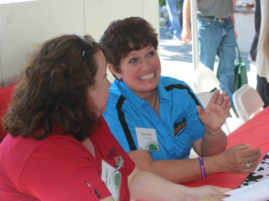 Renee Ebert chats with show organizers during the media events.