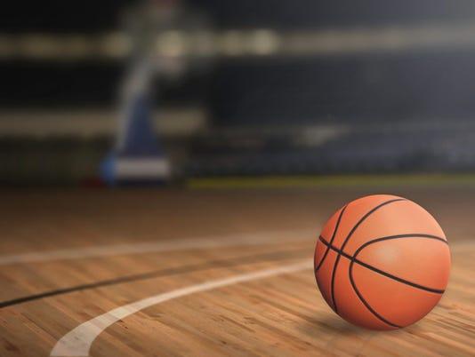 Basketball on Court Floor