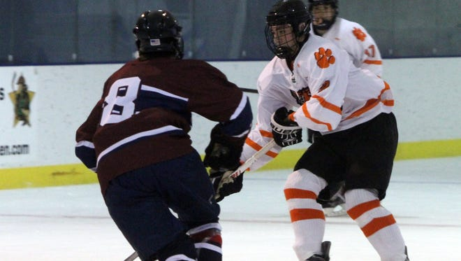 White Plains James Carrier moves the puck around The Harvey School's Brian Cicero during their game at the Guy Mathews Thanksgiving Invitational Hockey Tournament at Ebersole Ice Rink in White Plains, Nov. 25, 2016.