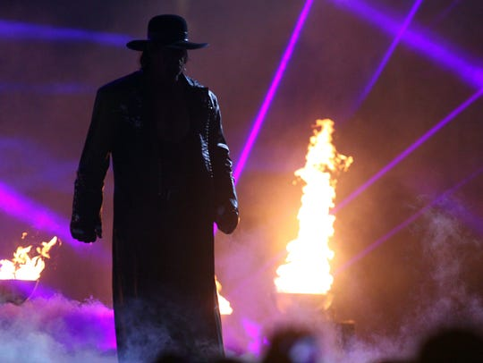 The Undertaker makes his entrance for a Hell In A Cell