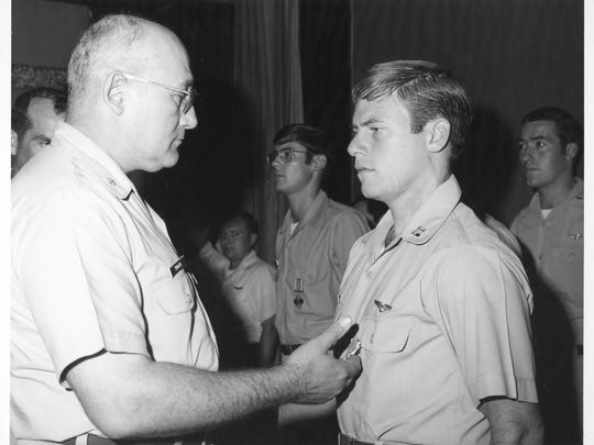 Gordon Bocher (right) received the Purple Heart after his plane was shot down over Vietnam.