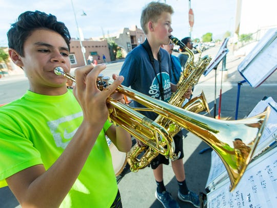 Brandon Rivera, left, and Zach Bowen, both 13, play with their band the Pink Pandas on Wednesday, May 11, 2016, during the first evening first evening of the Las Cruces Farmers and Crafts Market. The other members of the band are Ezra Medina, Trevor Gordon and Balam Sarellano, all 13-years-old.