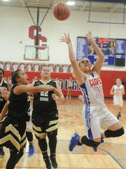 Cooper's Kindyl Wright (20) shoots over the Lubbock