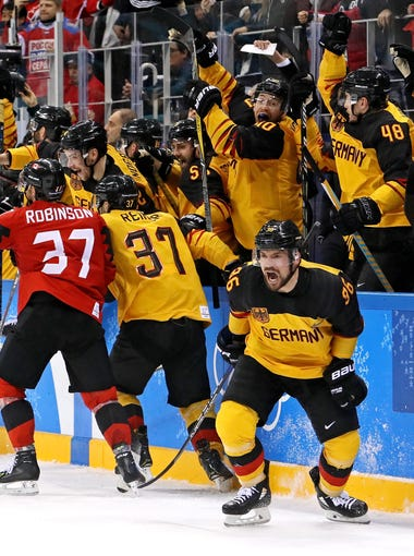 Germany celebrates beating Canada in the men's ice