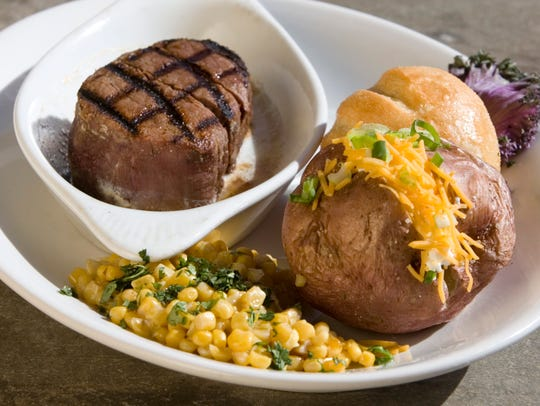 Eight oz. filet with a loaded baked potato served at