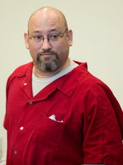 Mark Sievers enters the courtroom for a case management